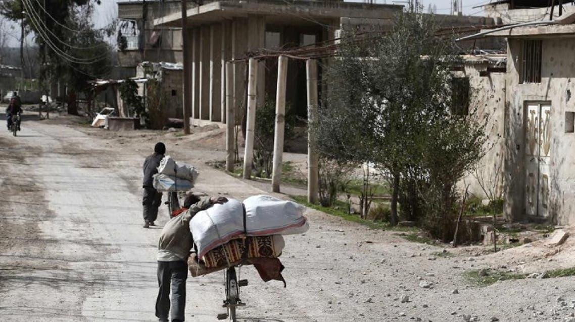 Syrians pack their belongings as they flee their home in the town of Utaya in the Syrian rebel enclave of Eastern Ghouta on March 1, 2018. (AFP)