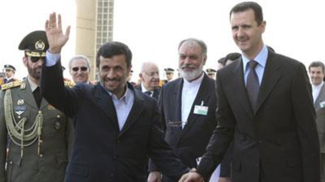 الأسد وأحمدي نجاد