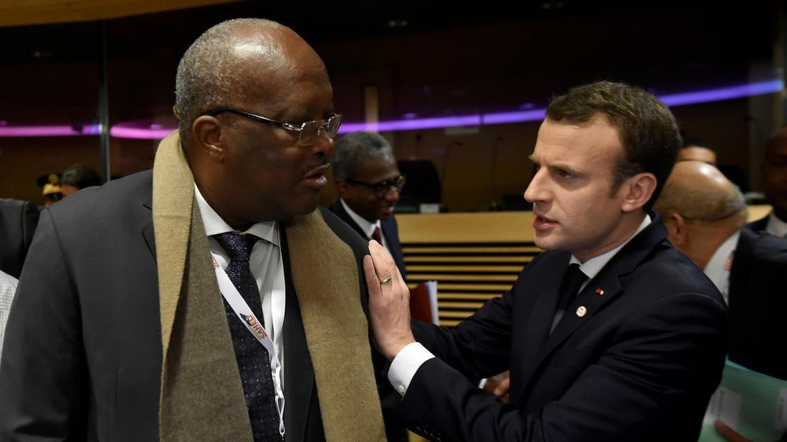 France's President Emmanuel Macron talks with Burkina Faso's President Roch Marc Christian Kabore during a High Level Conference on the Sahel in Brussels, Belgium February 23, 2018. REUTERS/John Thys/Pool