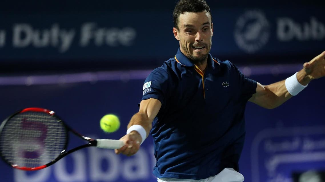 Spain's Roberto Bautista Agut returns the ball to Lucas Pouille of France (unseen) during their final match in the 2018 ATP Dubai Duty Free Tennis Championships on March 3, 2018. (AFP)