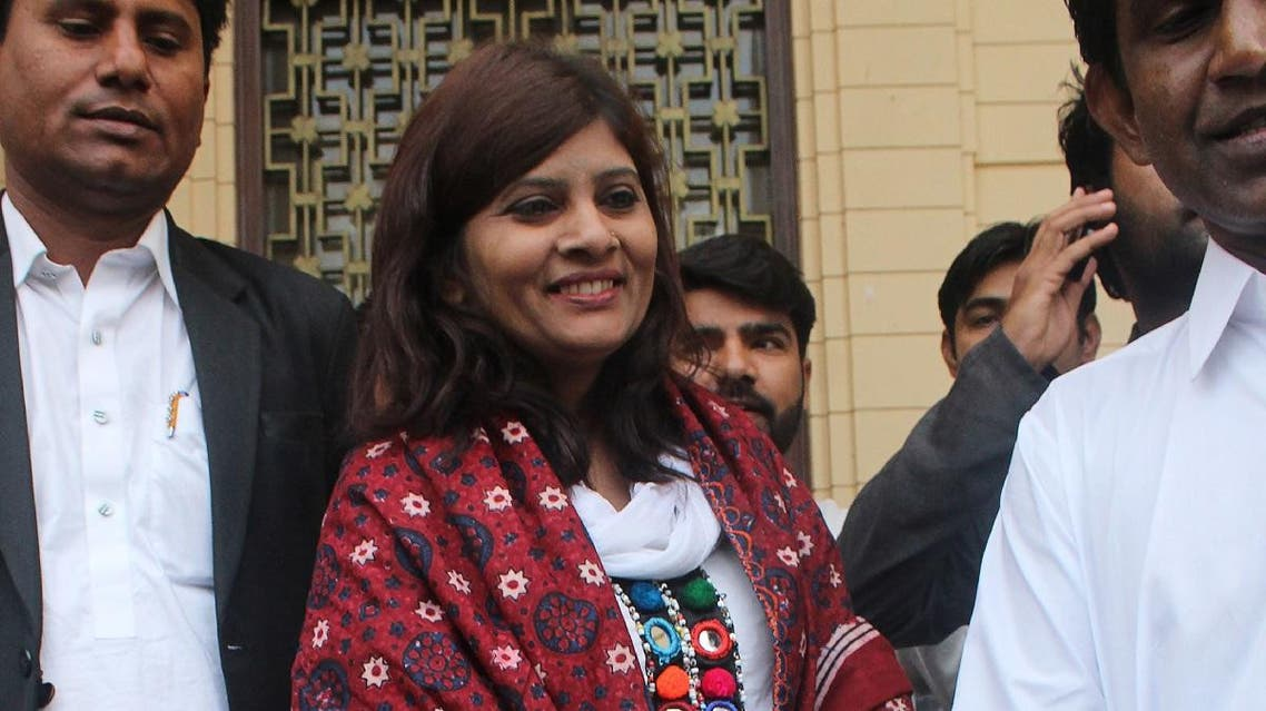 Pakistani opposition candidate Krishna Kumari Kohli is walking out from Sindh province assembly after the Senate election in Karachi. (AFP)