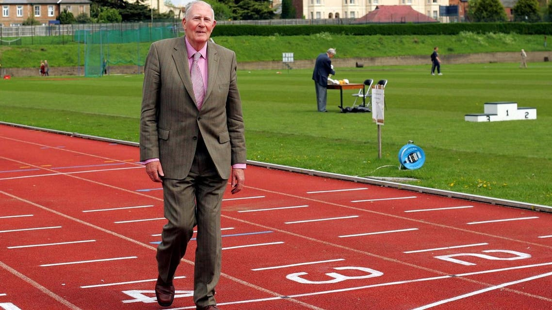 Sir Roger Bannister walks over the same finish line at the Iffley Road running track in Oxford that he crossed 50 years ago when he was the first man to run the sub four-minute mile, May 6, 2004. (Reuters)
