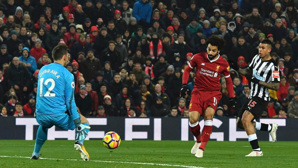 Liverpool's Mohamed Salah scores his side's first goal of the game against Newcastle, during the English Premier League match on March 3, 2018.