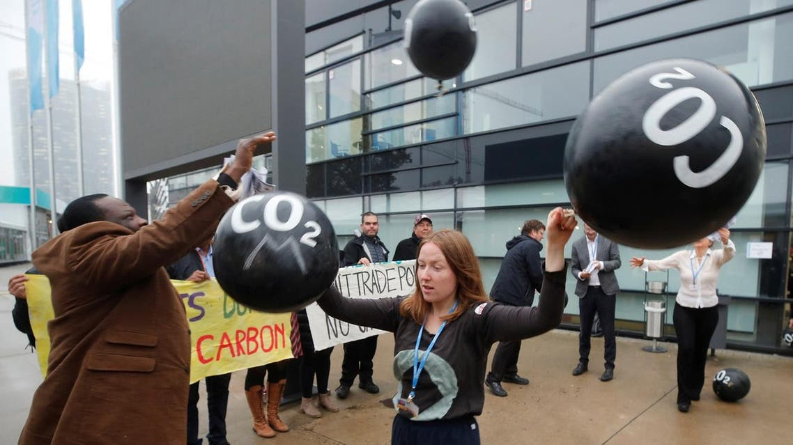 Activists protest against the carbon dioxide emissions trading in front of the World Congress Centre Bonn, the site of the COP23 UN Climate Change Conference, in Bonn, Germany, November 17, 2017. (Reuters)