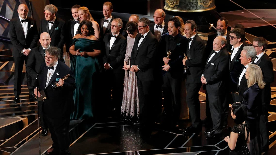 "Guillermo del Toro (L) accepts the Oscar for Best Picture for ""The Shape of Water."" (Reuters)"