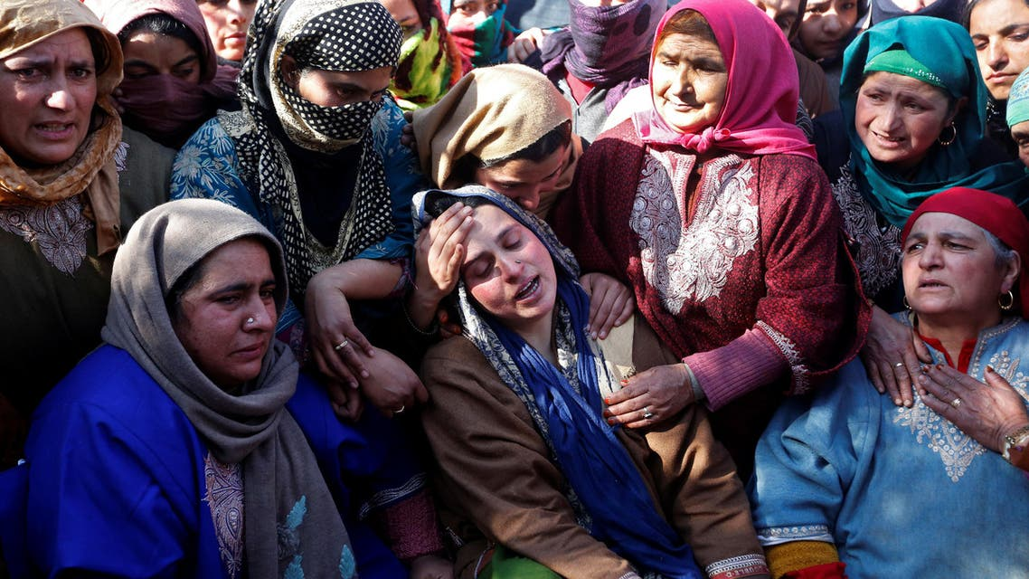 Relatives of Suhail Ahmad Wagay, a civilian, who according to local media died in a gunbattle between suspected militants and Indian security forces, mourn during his funeral procession at Pinjoora area of Kashmir's Shopian district, March 5, 2018. (Reuters)