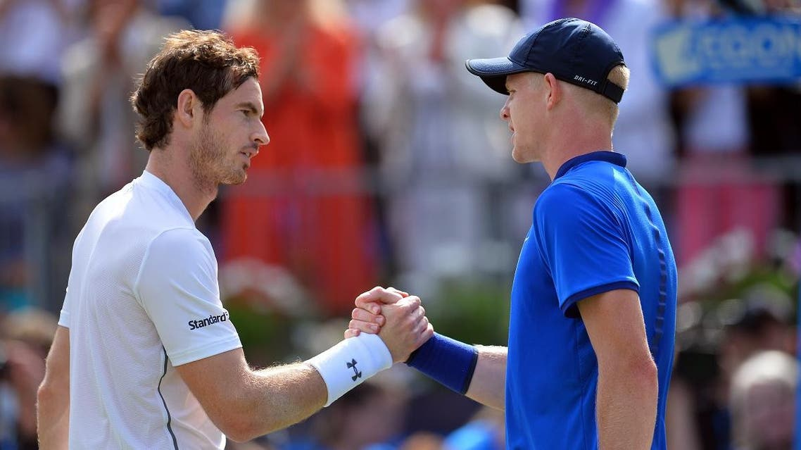 Britain's Andy Murray (L) shakes hands with Britain's Kyle Edmund (R) in their men's singles quarter-final match in the ATP Aegon Championships tennis tournament at the Queen's Club in west London on June 17, 2016. (AFP)