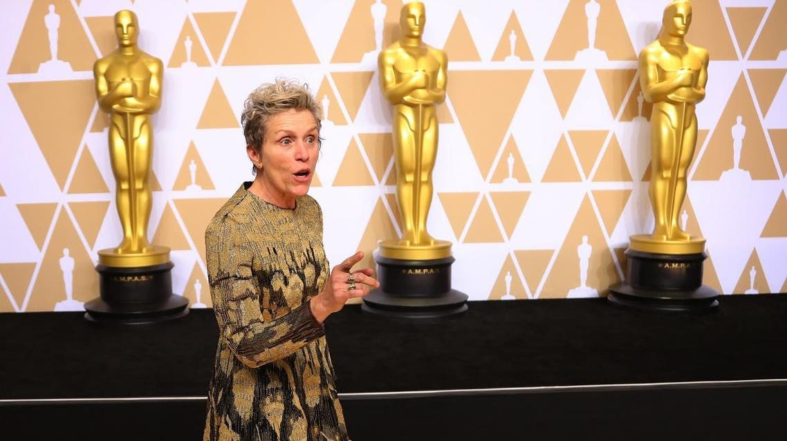 Frances McDormand poses backstage with her Best Actress Oscar. (Reuters)