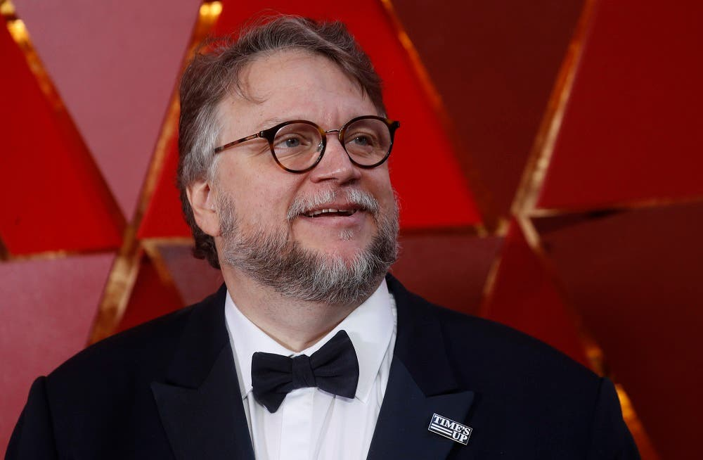 Best Director Nominee Guillermo del Toro wears a Times Up pin. (Reuters)