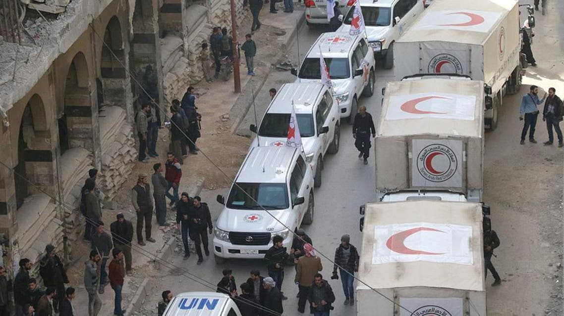 Trucks from Syrian Red Crescent and humanitarian partners are seen in Ghouta on March 5, 2018. (Reuters)