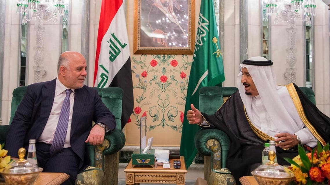 Haider al-Abadi is seen with Saudi King Salman in Jeddah in this photo released by SPA on June 19, 2017. (SPA via AP)