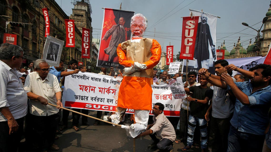 Activists burn Prime Minister Narendra Modi's effigy against the demolition of Lenin's statue in Kolkata on March 6, 2018. (Reuters)