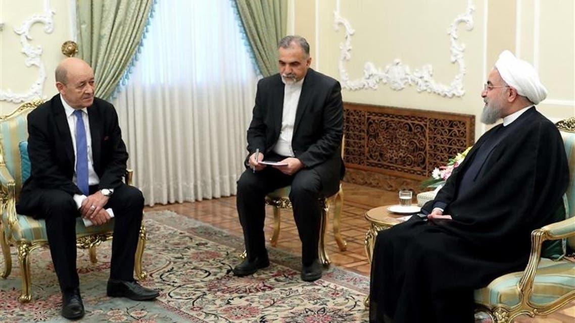 الرئيس الايراني حسن روحاني ووزير الخارجية الفرنسي جان ايف لودريان