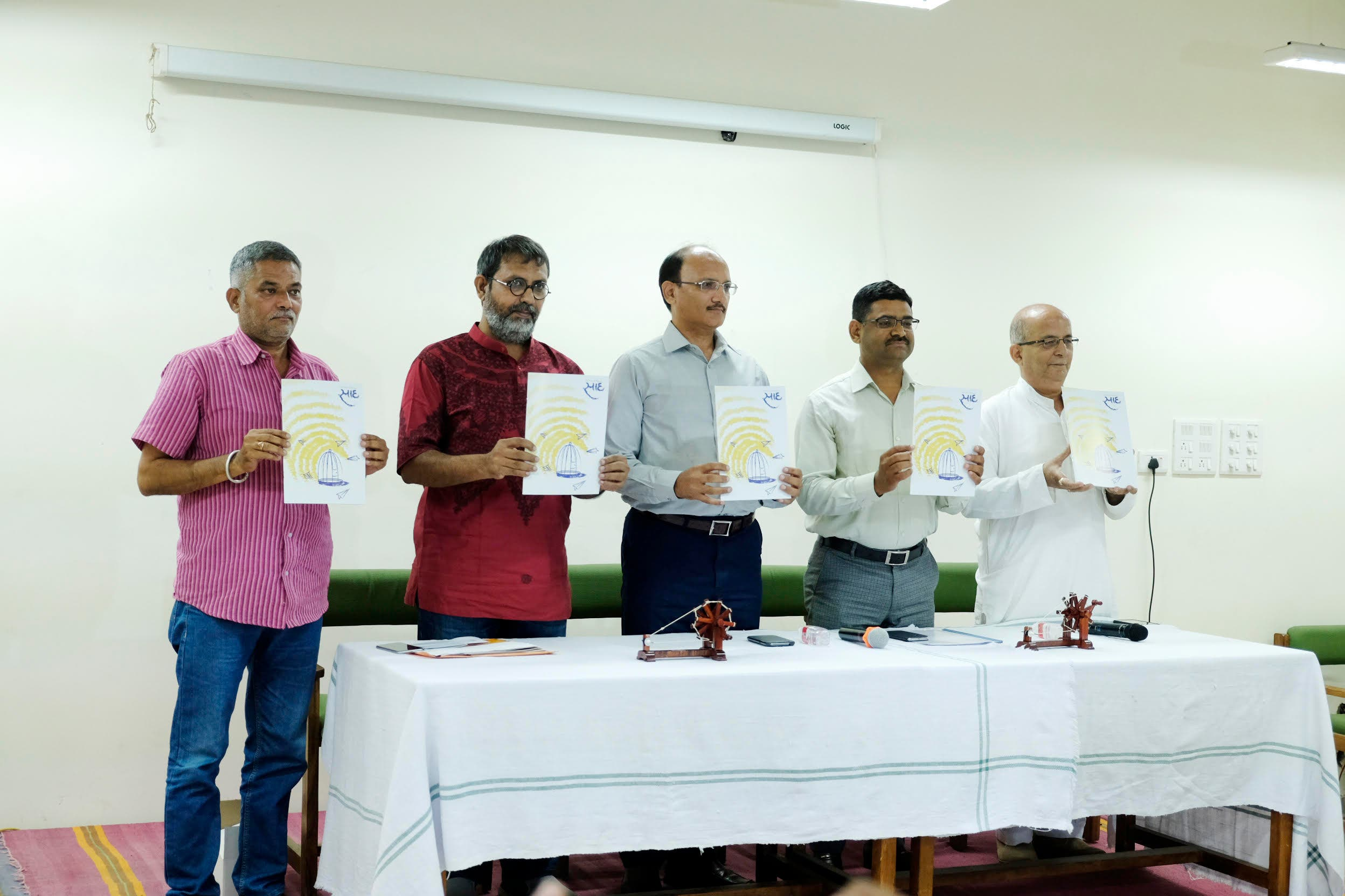 Vivek Desai's (second from left) Navjeevan Trust has offered to print prisoners' magazine free of cost. (Supplied)