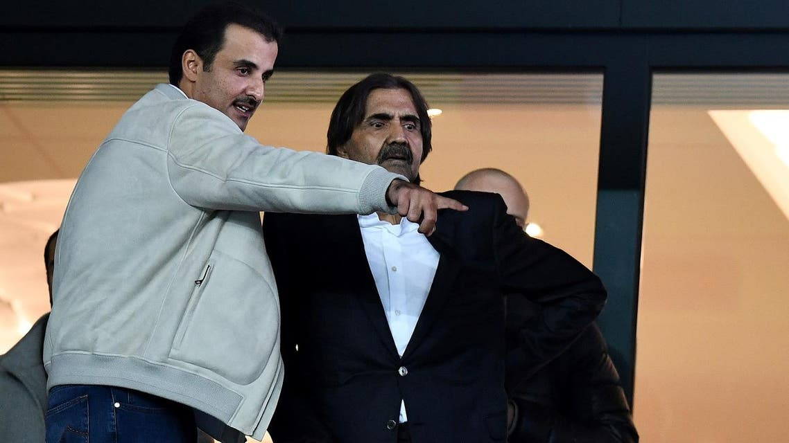 Qatar Emir Tamim Bin Hamad Al-Thani (L) speaks with his predecessor Hamad ben Khalifa Al Thani (C) as they arrive to attend the UEFA Champions League round of 16 second leg football match between Paris Saint-Germain (PSG) and Real Madrid on March 6, 2018, at the Parc des Princes stadium in Paris. (AFP)