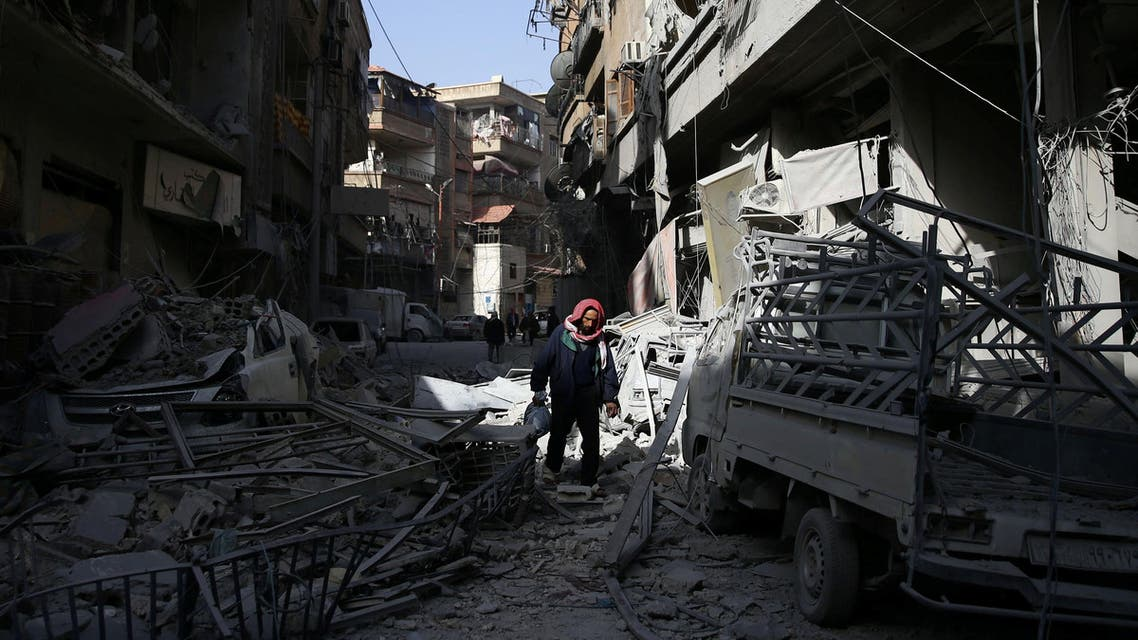 A man walks on the rubble of damaged buildings at the besieged town of Douma, Eastern Ghouta, Damascus, Syria March 5, 2018. REUTERS/Bassam Khabieh