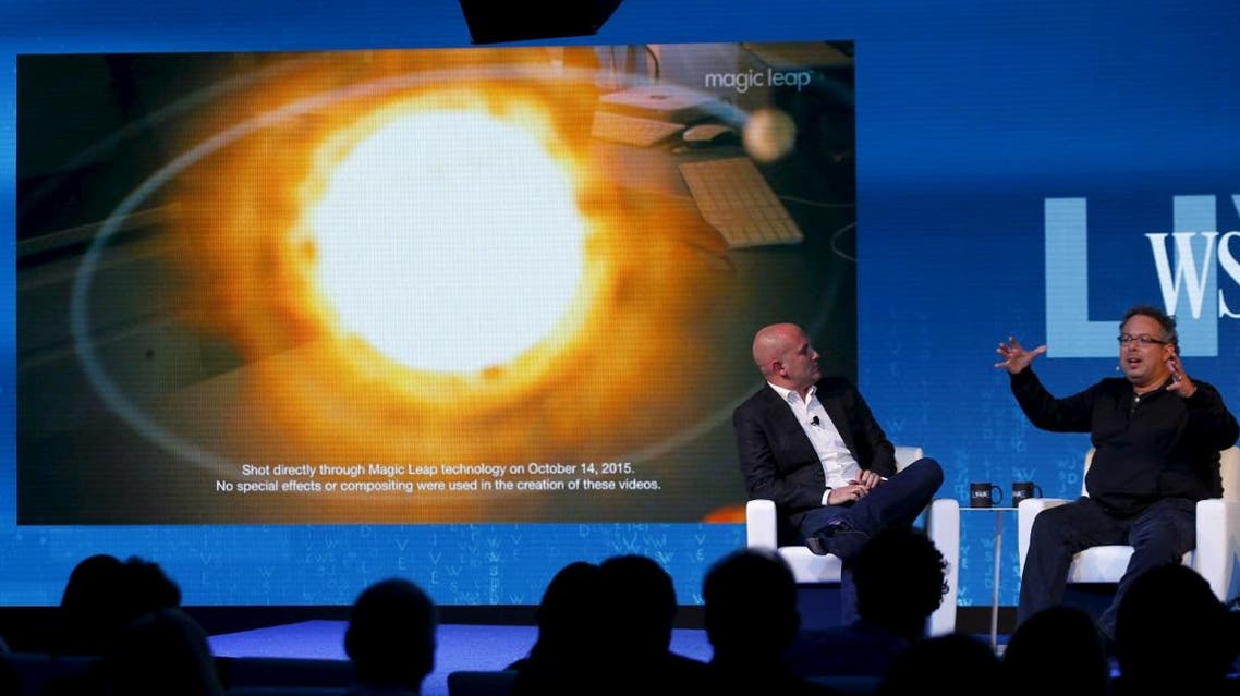 Rony Abovitz, founder president and CEO of Magic Leap (R) unveils a view of his companies augmented reality with Rio Caraeff, chief content officer, at the Wall Street Journal Digital Live ( WSJDLive ) conference. (Reuters)