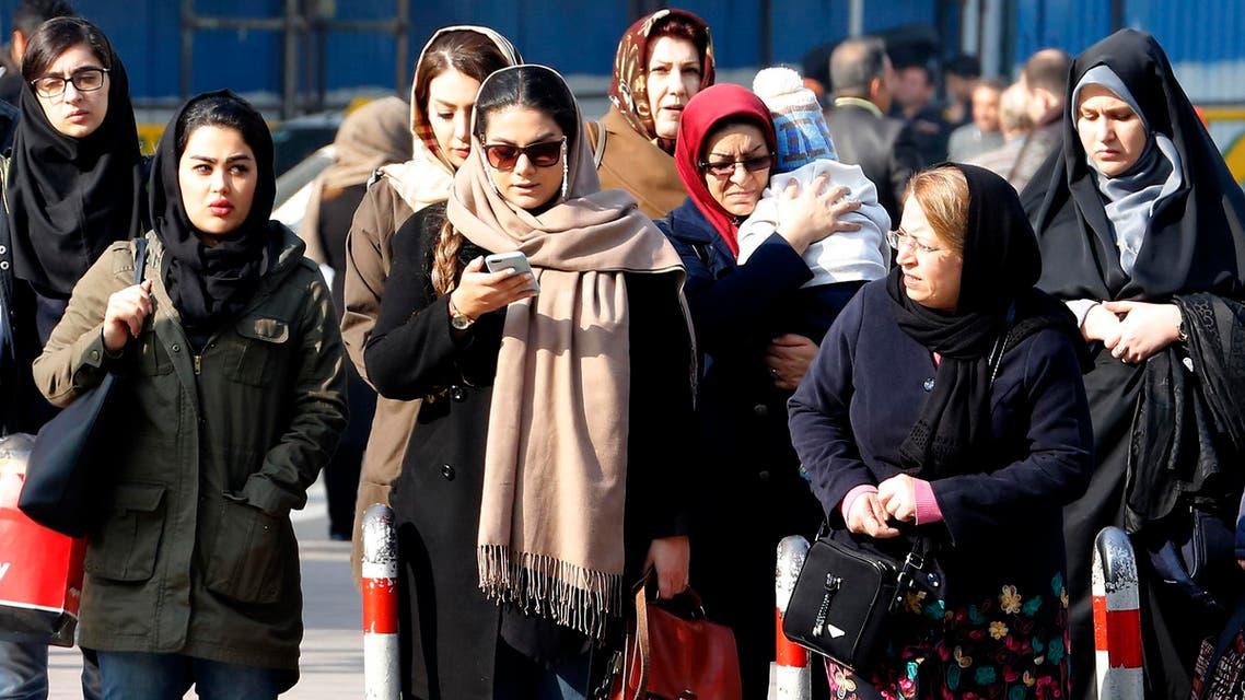 Iranian women wearing hijab walk down a street in Tehran on February 7, 2018. (AFP)