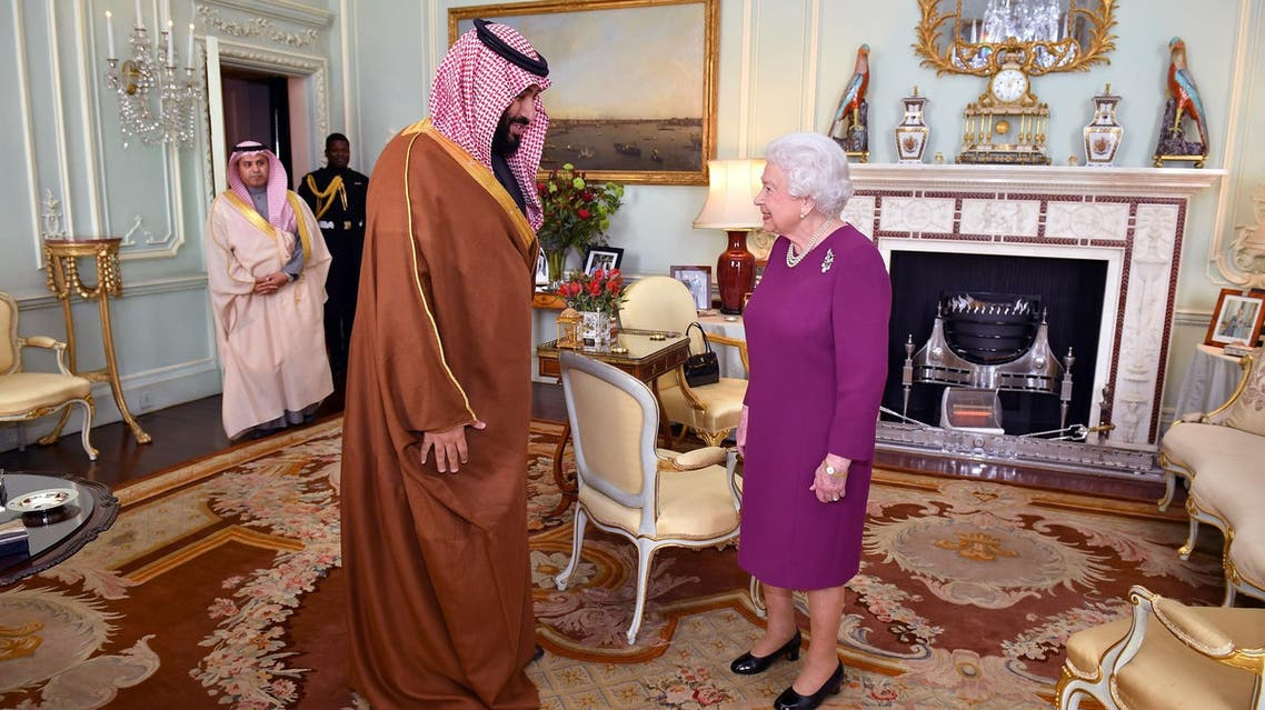 Britain's Queen Elizabeth greets Mohammed bin Salman during a private audience at Buckingham Palace in London on March 7, 2018. (Reuters)