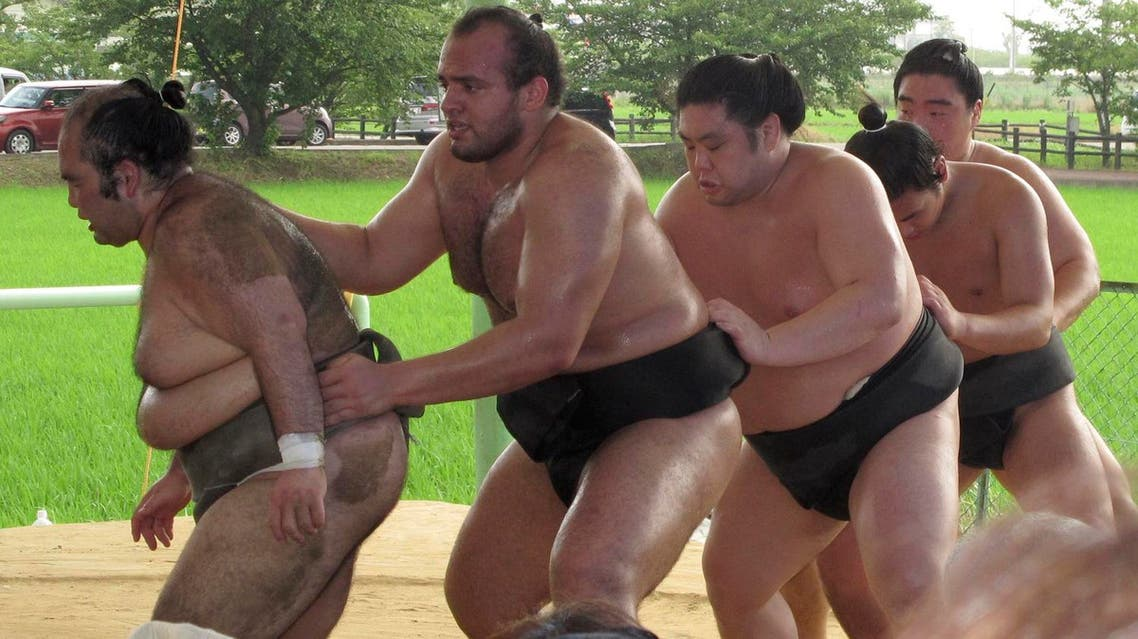 In this file photo, Egyptian sumo wrestler Osunaarashi (second from left), trains with his stablemates in Inazawa, near Nagoya, central Japan. (AP)