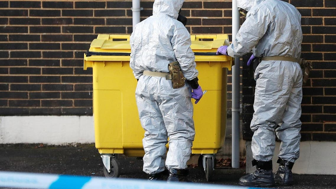 Soldiers wearing protective suits seal a bin at an ambulance station in Salisbury, Britain, on March 10, 2018. (Reuters)