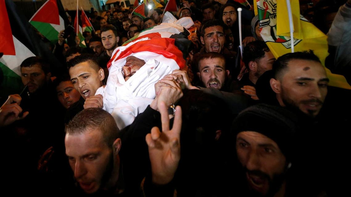 Mourners carry the body of Palestinian Mohammed al-Jabari during his funeral in Hebron, in the occupied West Bank on March 9, 2018. (Reuters)