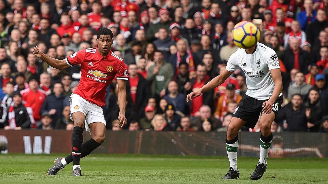 Manchester United's English striker Marcus Rashford (L) scores the opening goal against Liverpool in the Premier League on Saturday. (AFP)