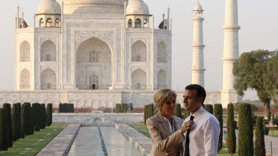 French President Emmanuel Macron and his wife Brigitte Macron pose for a photograph at the Taj Mahal in Agra, India March 11, 2018. REUTERS/Ludovic Marin/Pool