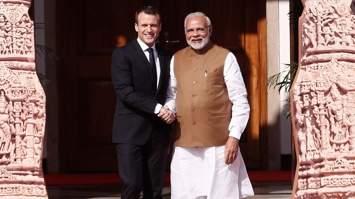 Prime Minister Narendra Modi and French President Emmanuel Macron arrive to attend the International Solar Alliance Founding Conference in New Delhi on March 11, 2018. (Reuters)