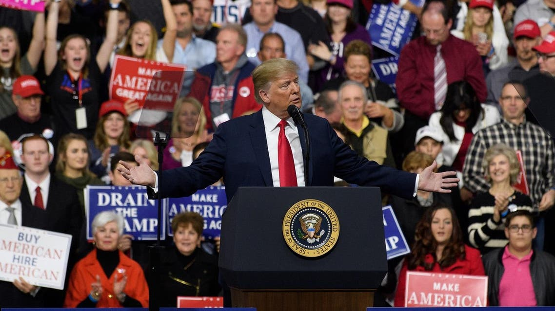 President Donald J. Trump speaks to supporters at the Atlantic Aviation Hanger on March 10, 2018 in Moon Township, Pennsylvania. (AFP)