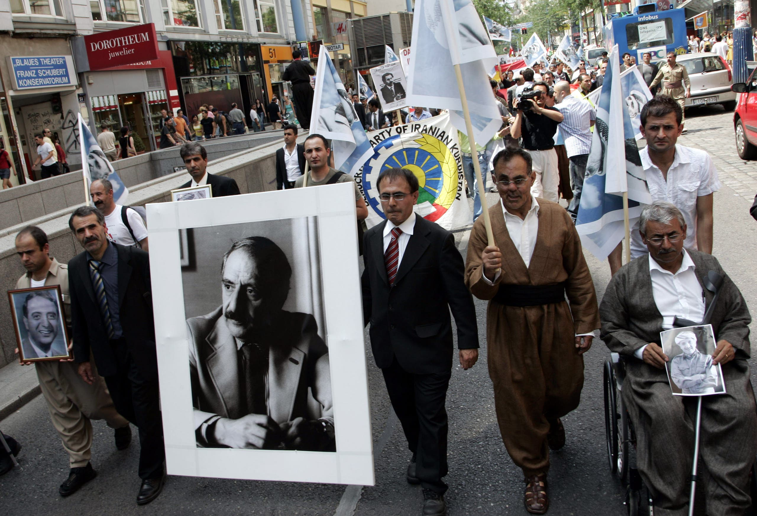 Hundreds of demonstrators take part in a demonstration 17 years ago in Vienna on Thursday, 13 July 2006 in Vienna, on the occasion of the killing of Kurdish Secretary-General Abdul Rahman Ghassemlou of PDKI. (AP)