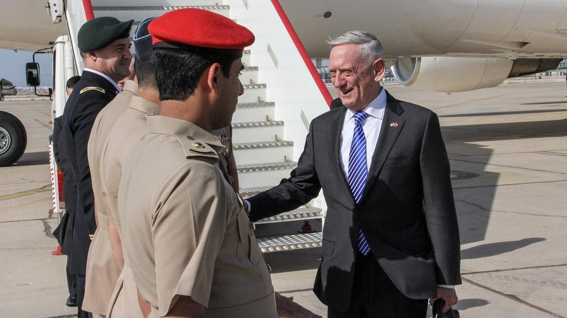 US Secretary for Defense Jim Mattis (R) shakes hands with Omani officials upon his arrival in the capital Muscat on March 11, 2018.  (AFP)