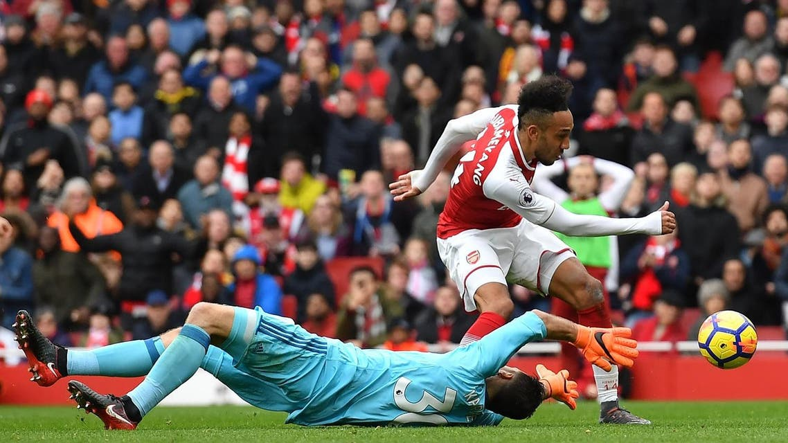 Arsenal's Gabonese striker Pierre-Emerick Aubameyang scores Arsenal's second goal past the outstretched arms of Watford's Greek goalkeeper Orestis Karnezis on March 11, 2018. (AFP)