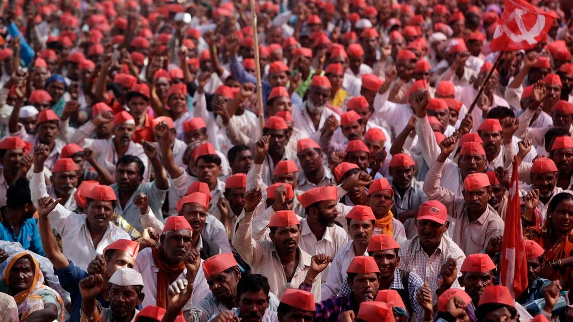 Indian farmers shout slogans during a rally at the end of their six day long march on foot, in Mumbai, India, Monday, March 12, 2018. AP