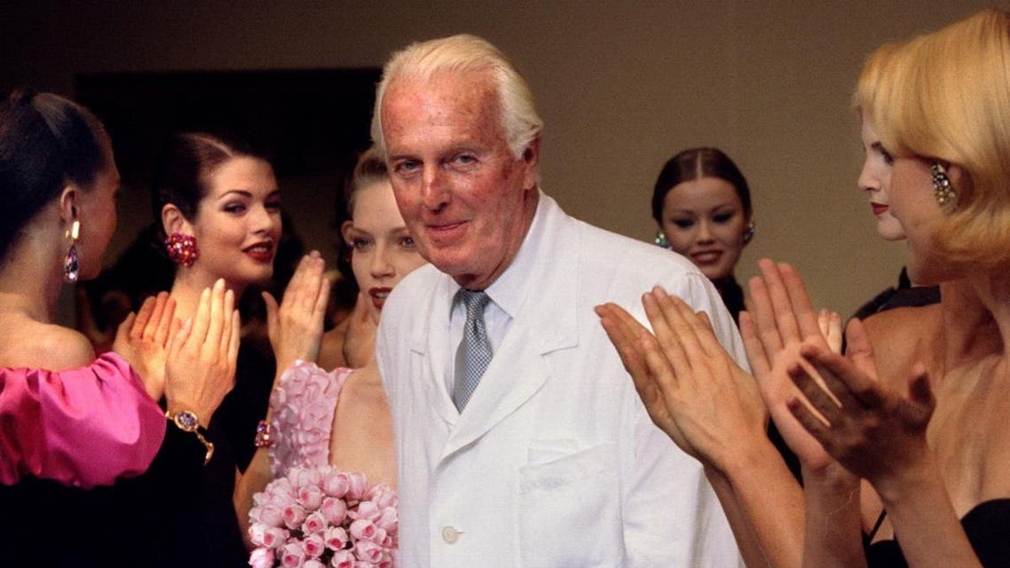 French fashion designer Hubert de Givenchy is applauded by the models after he presented his last High Fashion collection Autumn/Winter 1995 in Paris. (Reuters)