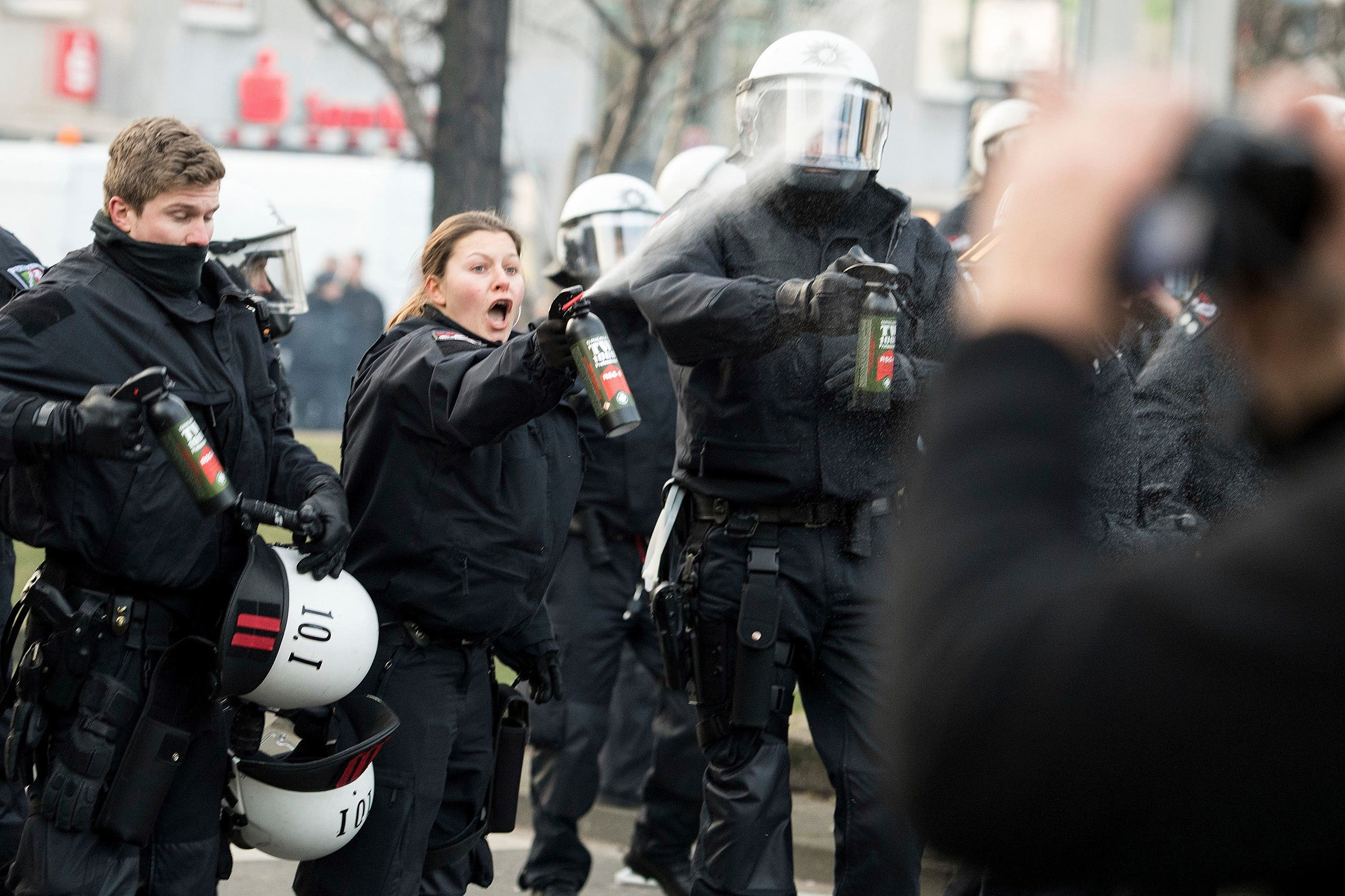 Police uses pepper spray as they clash with demonstrators in Cologne, Germany Saturday, Jan. 27, 2018 after Kurdish immigrants and supporters protested against a Turkish military operation in a Kurdish enclave in northern Syria. (AP)