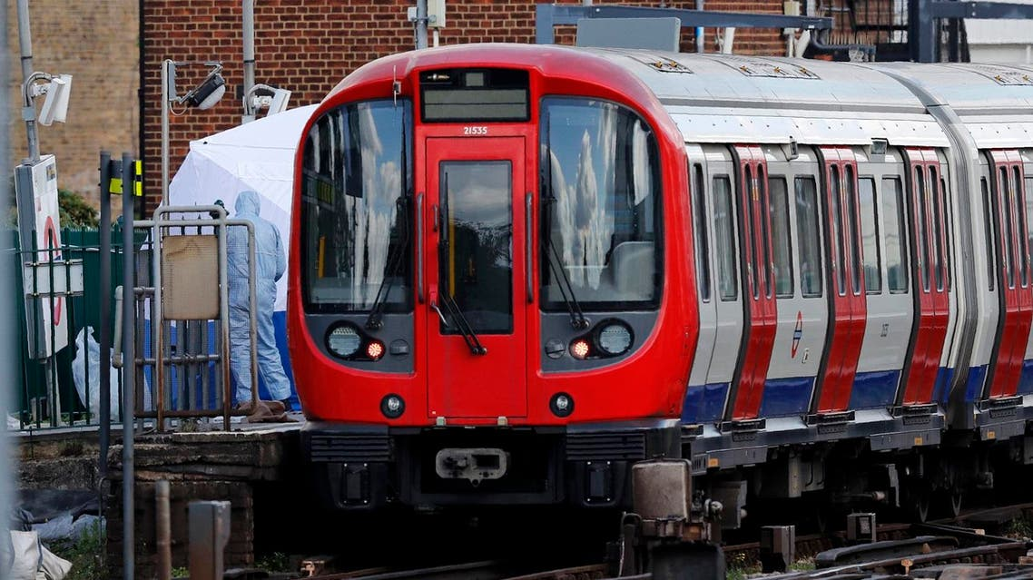Forensics officers work alongside an underground tube train at a platform at Parsons Green underground tube station in west London on September 15, 2017. (AFP)