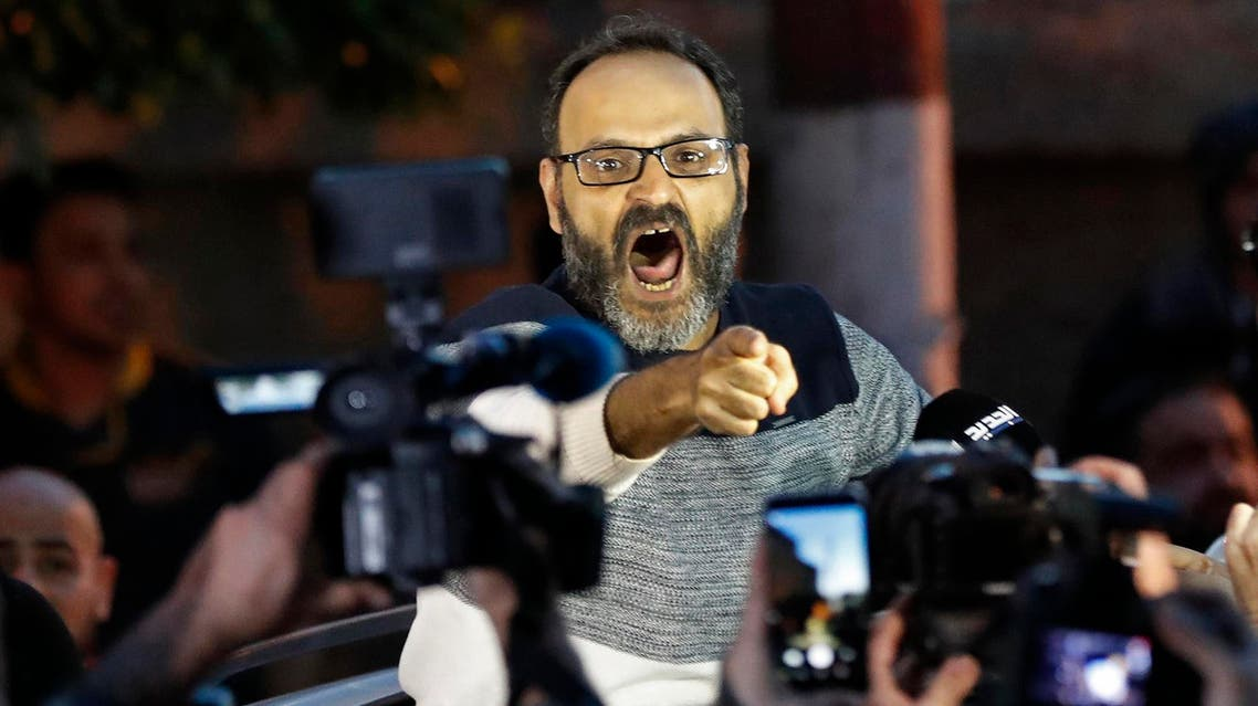 Ziad Itani shouts as he speaks with journalists after he was released by Lebanese authorities, at his house, in Beirut on March 13, 2018. (AP)