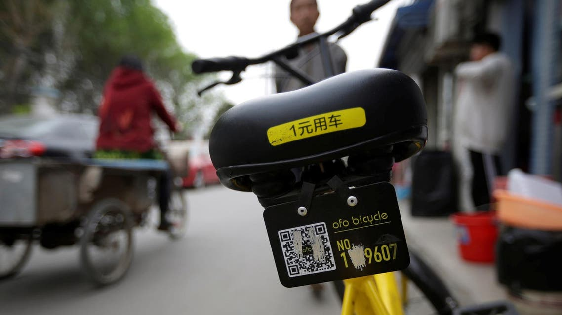A damaged Ofo's shared bike is parked at a residential area on the outskirts of Beijing on April 16, 2017. (Reuters)