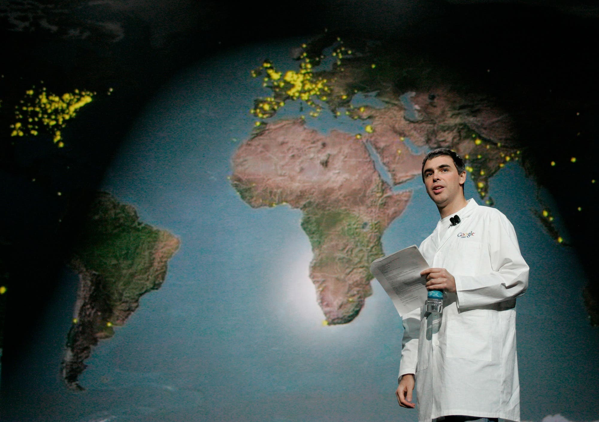 Larry Page walks by a map of the world during keynote speech at the Consumer Electronics Show in Las Vegas, Nevada, on January 6, 2006. (Reuters)