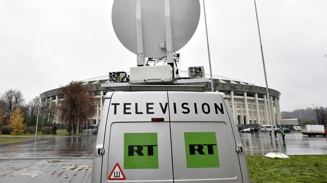 Russia Today (RT) television broadcast van parked ahead of a friendly football match between Russia and Argentina in Moscow on November 11, 2017. (AFP)
