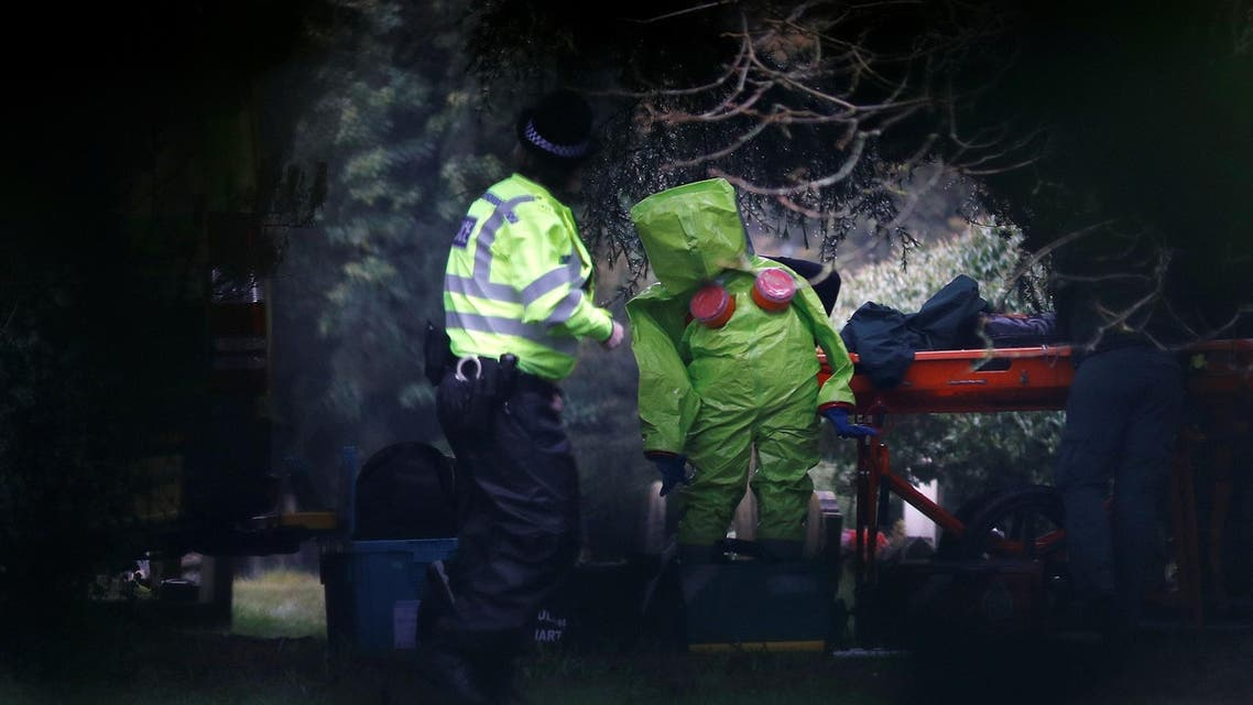 Members of the emergency services put on protective suits near to the grave of Luidmila Skripal, wife of former Russian intelligence agent Sergei Skripal, at the London Road Cemetery in Salisbury, Britain, March 10, 2018. (Reuters)