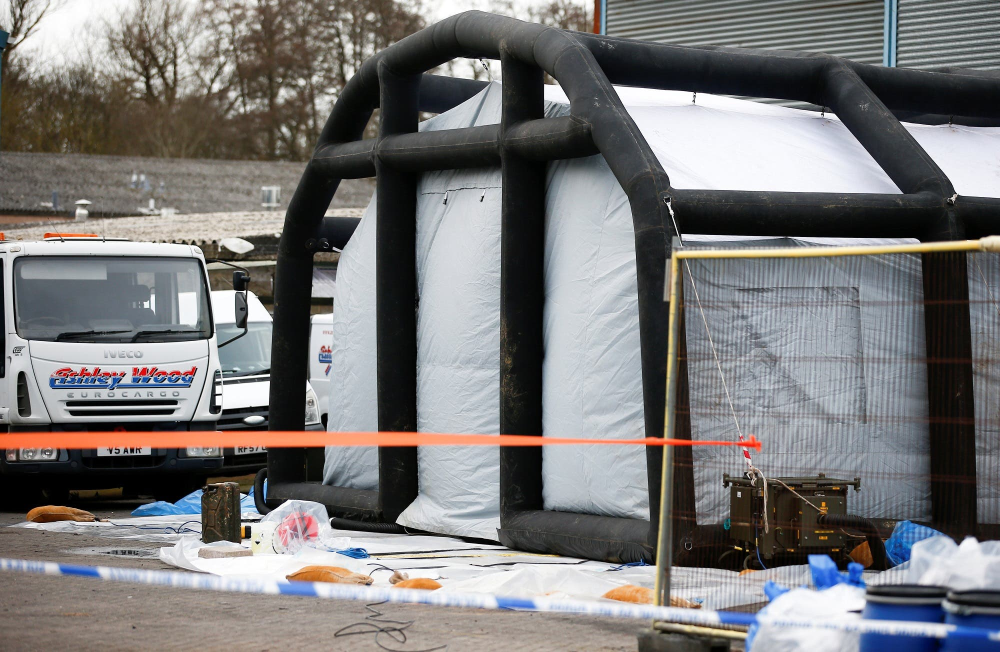 Police tape and bagged items are seen near an inflatable structure in the courtyard of Ashley Wood Recovery; where emergency services worked following the poisoning of former Russian intelligence officer Sergei Skripal and his daughter Yulia; in Salisbury, Britain, on March 14, 2018. (Reuters)