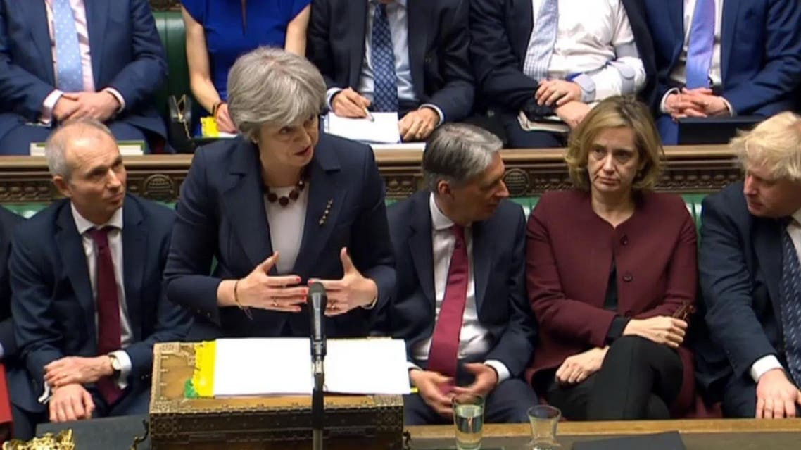 Britain's Prime Minister Theresa May speaks during the scheduled Prime Minister's Questions in the House of Commons, London, on March 14, 2018. (AP)