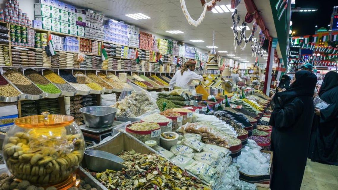 DUBAI, UAE - DECEMBER 4, 2017: Seller of of spices in the park entertainment center Global Village. (Shutterstock)