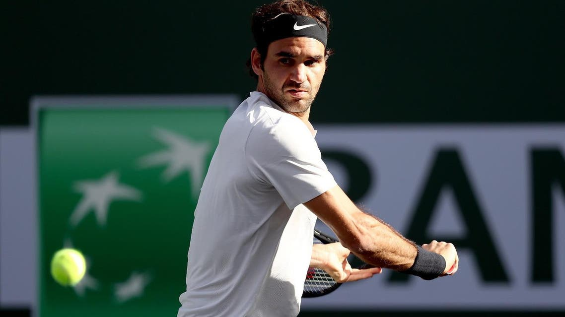 Roger Federer returns a shot against Jeremy Chardy of France during the BNP Paribas Open at the Indian Wells Tennis Garden on March 14, 2018 in Indian Wells. (AFP)