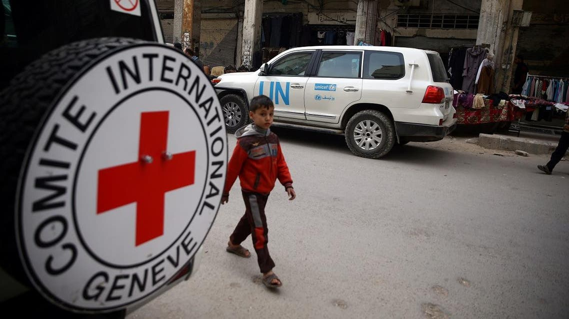 A Syrian child is seen walking near International Red Cross vehicle in the rebel-held city of Douma. (File photo: Reuters)