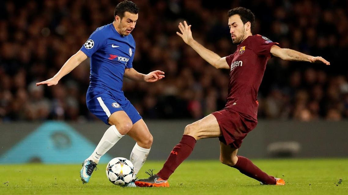 Chelsea's Pedro in action with Barcelona's Sergio Busquets. (Reuters)