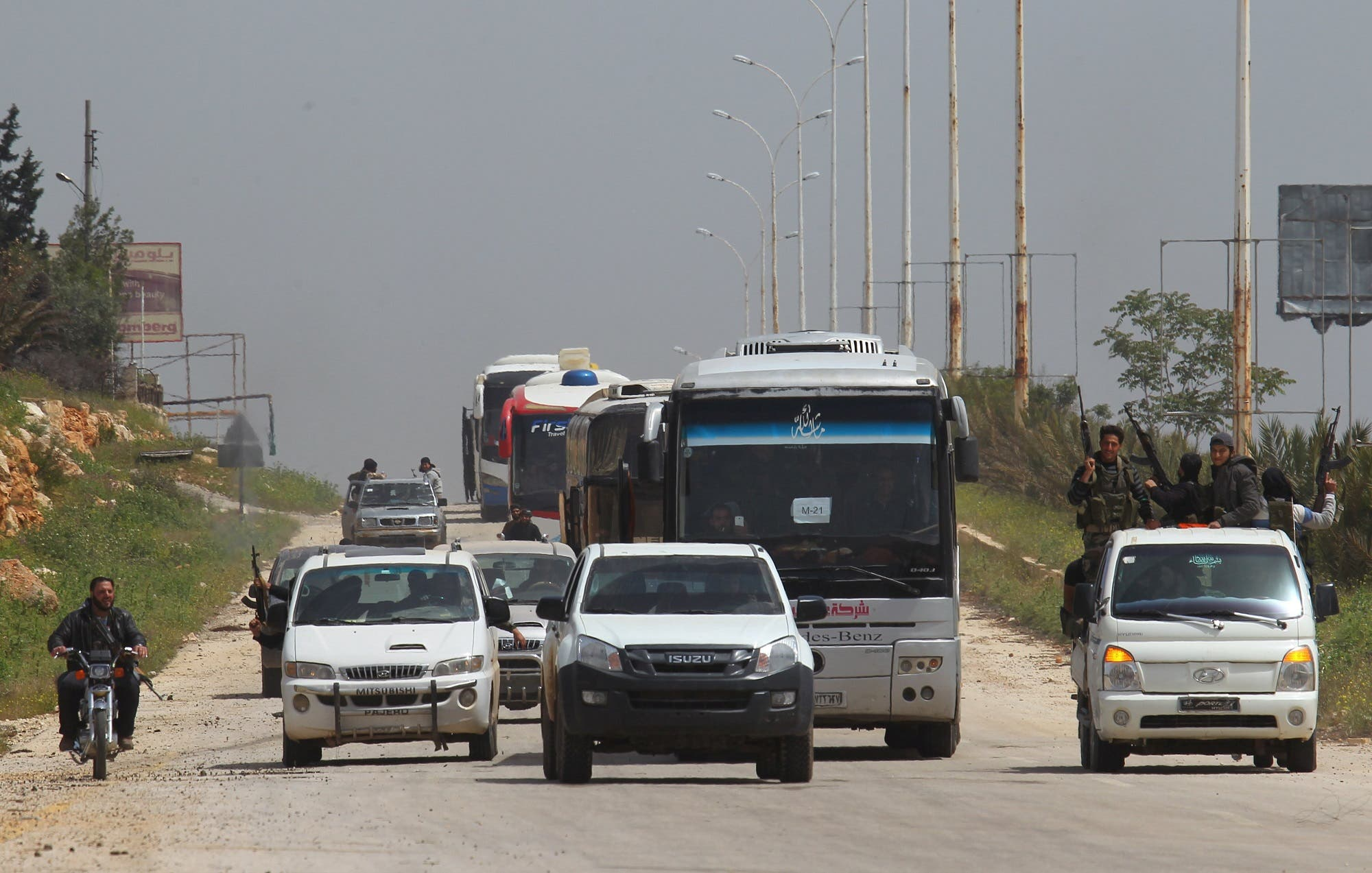 A convoy of buses carrying Sunni rebels and civilians, who were evacuated from Zabadani and Madaya, as part of a reciprocal evacuation deal for four besieged towns, travels towards rebel-held Idlib, Syria April 21, 2017. (Reuters)