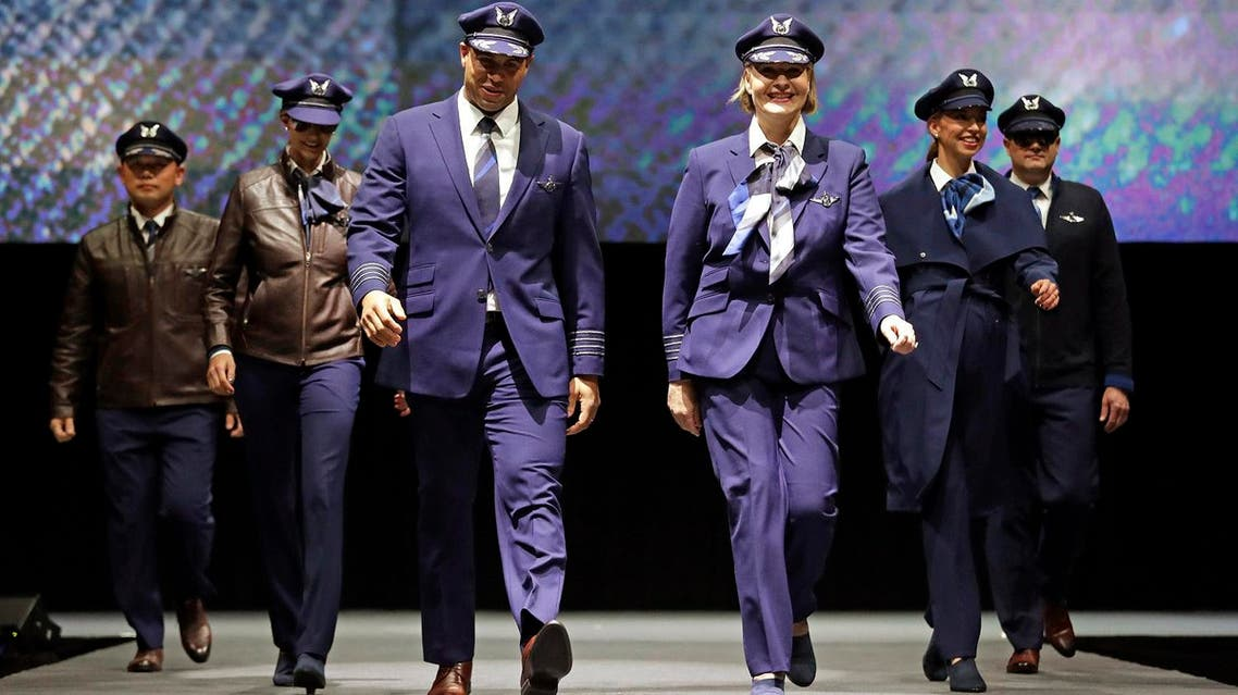 Pilots walk the runway during an unveiling of Alaska Airline's new employee uniforms on January 18, 2018, in SeaTac, Washington.